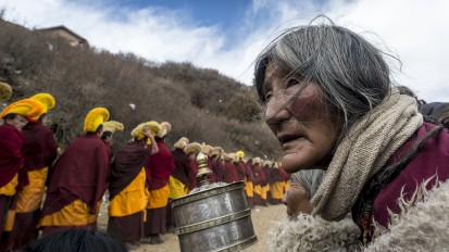 Pilgrim with prayer wheel